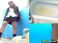 Hot Asian chick is being spied on while taking a piss