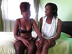 Horny African babes toying each other pussies in bedroom