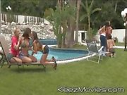 Horny young bitches spread all around the pool spread their legs and lick