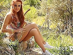 Lucy Anne strips nude in the rock garden