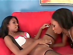Lesbo in stockings fucked with a glass dildo