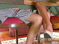 Stepmom jacks off boy under the table