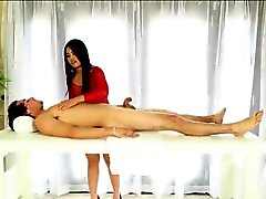 Asian masseuse blowjobs and facialed under the massage table
