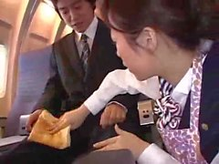 Stewardess forced handjob in plane
