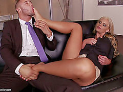 Horn-avid blondie with pleasing milk shakes and fine rounded a-hole is fond of giving a footjob