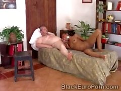 Smoking ebony slut puts a huge European cock in her filthy mouth