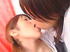 Pretty Japanese babes kiss each other and engage in intense