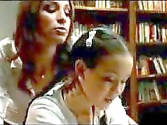 Schoolgirl In Skirt Getting Spanked By Other Girl In The Library