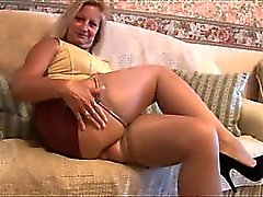 Mature blonde with great body in tight mini skirt