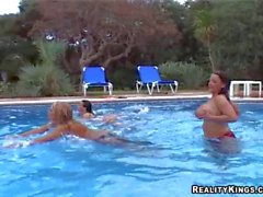 Ewa Sonnet and her busty friends are topless by the pool
