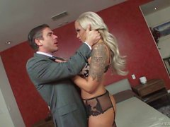 Busty MILF with tattoos Nina Elle gets a mouthful of cock