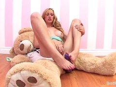 Brett Rossi plays with a stuffed bear's strap-on dildo