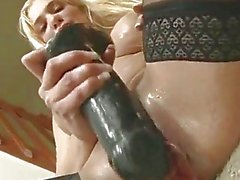 Tatiana inserting a big fat dildo deep