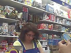 Chubby brunette cashier with enormous boobs caught on a spy