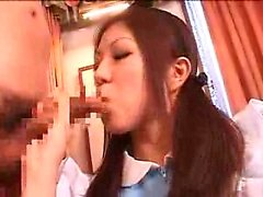 Slutty Asian maid flashes her sexy curves and worships two