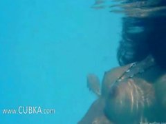 Naughty schoolgirl stripping in the pool