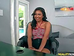 Latina Issa strips down to her red panties on cam
