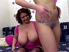 Hot brunette screwing a chubby mature with a dildo