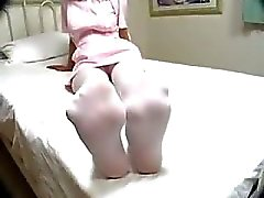 Nurse In Uniform And Pantyhose Giving Footjob On The Bed In The Hospital