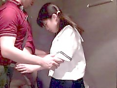 Pigtailed asianteen sucking in hallway