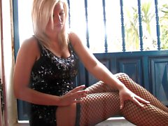 Stocking clad babe in a window gets saucy