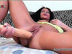 Brunette slut fucking her craving twat with baseball bat