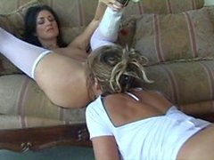 Lusty nurses play role and enjoy fucking their pussy with a strap-on