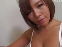 Short-haired Japanese girl with big tits blows