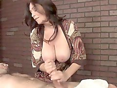 Classy mature masseuse with monster tits tugs