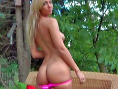 Shaved babe Sophia Knight takes off her pink bikini outside