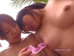 2 Asian Girls Stimulating Their Nipples With Toys On The Couch