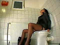 Masturbation at work, anal toying at the toilet