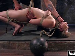 Tattooed guy punishes her with a toy