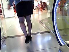 Fishnet stockings upskirt on escalator 2