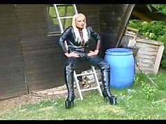 Sexy domina torturing a hot girl outdoor