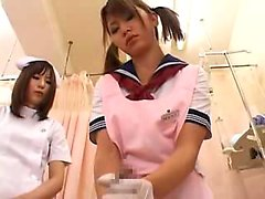 Pigtailed Japanese nurse knows how to work her hands on a t