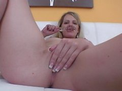 Slut strips and rubs her cunt on the couch