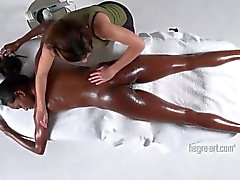 Black babe is massaged and vibed by a masseuse