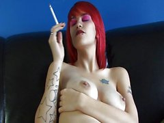 Sexy smoker touches herself as she puffs