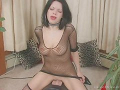 Goth babe in a fishnet top masturbates