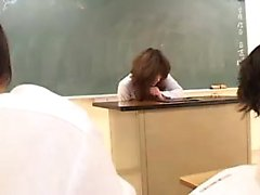 Insatiable Japanese teacher with sexy legs fingers her achi