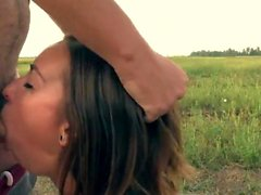 Slim brunette teen gives an outdoor blowjob