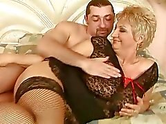 Grandma in fishnet stockings enjoys hot sex