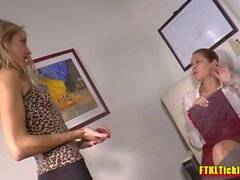 Brunette boss makes her blonde secretary worship her sexy feet