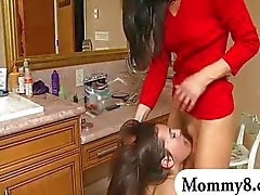 MILF stepmom and teen get caught eating pussy