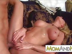 MILF Nicole Sheridan blows younger guy