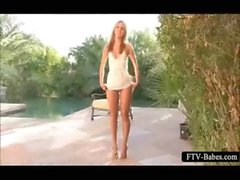Blonde teen sweetie rubbing her clit by the pool