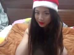 Asian Santa Cam Girl Rides Sybian