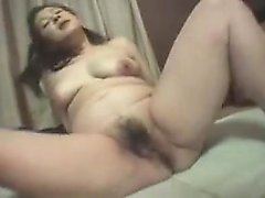 Seductive Oriental mom with big natural boobs enjoys a deep