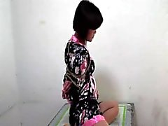 Layers of gag on bound Chinese girl